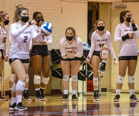 The SIU volleyball bench gets hyped as freshman MacKenzie Houser prepares to serve against Missouri State on Saturday, Jan. 30, 2021 in  Davies Gym at SIU. The Salukis would go onto to fall to the Bears 3-2 in the Salukis