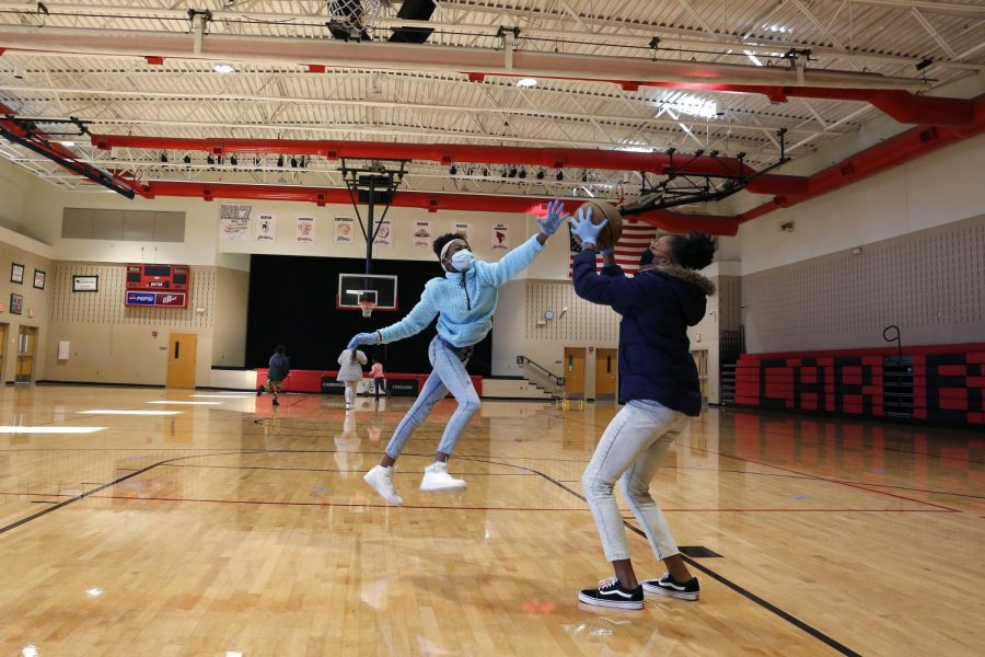Carbondale Middle School students, Alliyah T., left, and Neviah L., play basketball during a physical education class on the last day of in-person learning, Carbondale, IL, Friday, November 13, 2020.