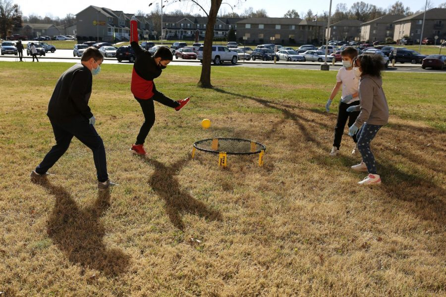 Students at Carbondale Middle School, from left: Hayden M.; Nath W.; Alexi K.; and, Marley S. participate in games during their physical education class on the last day of in-person learning, Friday, November 13, 2020.