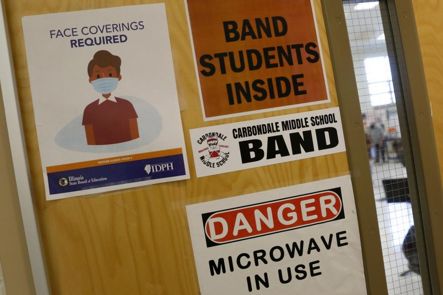 At Carbondale Middle School, an Illinois State Board of Education sign on a classroom door instructs anyone entering that face masks are required, Friday, November 13, 2020.