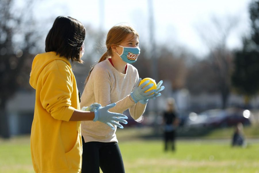 Carbondale Middle School students, Elise N., left, and Alice S., play a game during a Physical Education class on the last day of in-person learning, Friday, November 13, 2020.