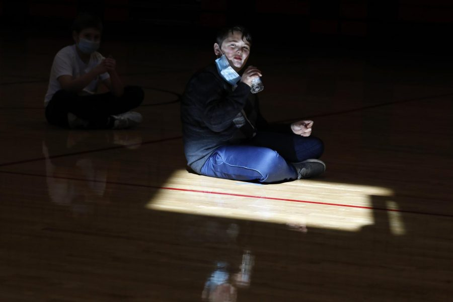 Carbondale Middle School student Hayden M. drinks from a plastic water bottle after gym class on the last day of in-person learning at the school, Friday, November 13, 2020.