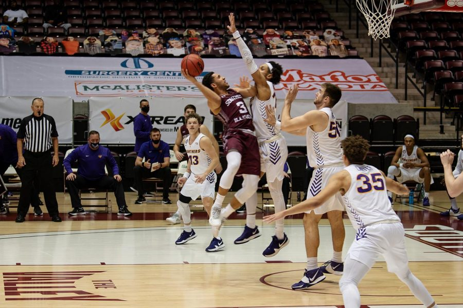 Dalton Banks(3) jumps with the ball in front of Chinedu Kingsley Okanu (11) during the SIU vs Northern Iowa basketball game. Jan. 31, 2021, at the SIU Bantera Center in Carbondale, Ill.