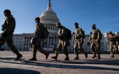 Members of the National Guard, outside the U.S. Capitol Building, a day after the House of Representatives impeached President Donald Trump, and over a week after a pro-Trump insurrectionist mob breached the security of the nation's capitol, on Thursday, Jan. 14, 2021, in Washington, D.C.