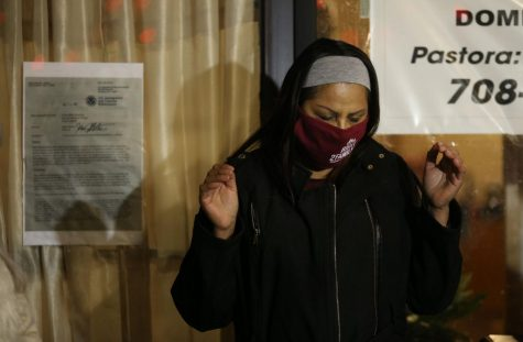 Francisca Lino prays with supporters outside the Adalberto Memorial United Methodist Church, 2716 W. Division St., before heading home to Romeoville on Jan. 23, 2021, in Chicago. (John J. Kim / Chicago Tribune/TNS)