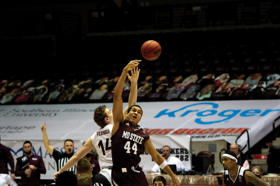 Kyler Filewich (14) battles during the tip-off in the game against Missouri State University on Wednesday, Feb. 17, 2021, in the Banterra Center at SIU. The Salukis lost the game by 15 points with a final score of 53-68.