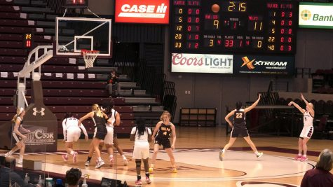 SIU guard, Caitlin Link (5), shoots the ball from a distance attempting to catch the team's score back up to the Valparaiso Crusaders Saturday, February 27, 2021, in Carbondale, Ill.