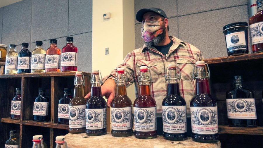 """Derek Ervin of Glacier's End discusses the differences between each flavor of his unique vinegar syrup Saturday, February 27, 2021, in Carbondale, Ill.  """"The berry ones go great with vodka. They all go good with rum … I guarantee ya, you try one you're gonna be hooked,"""" Ervin said."""