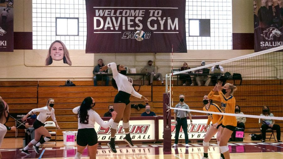 Middle Hitter Imani Hartfield takes a huge leap to spike the ball Sunday, Feb. 21, 2021, at Davies Gym in Carbondale, Ill.