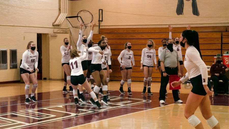 The SIU Women's Volleyball team celebrates after a heated play Sunday, Feb. 21, 2021, at the Davies Gym, in Carbondale, Ill.
