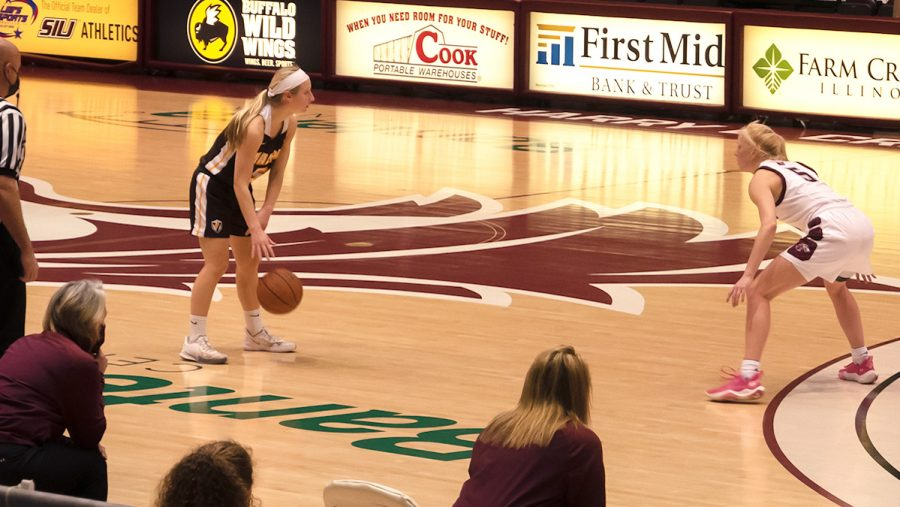 Valparaiso guard, Shay Frederick (5 left) squares off with SIU guard, Caitlin Link (5 right) Saturday, February 27, 2021, in Carbondale, Ill.