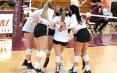 SIU Women's Volleyball players form a circle to cheer up and plan a tactical move to get level with the opponent team from Loyola University on Sunday, Feb. 7, 2021, in Davies Gym at SIU. The Salukis went on to lose in all three sets with score lines of 22-25, 13-25 and 17-25.