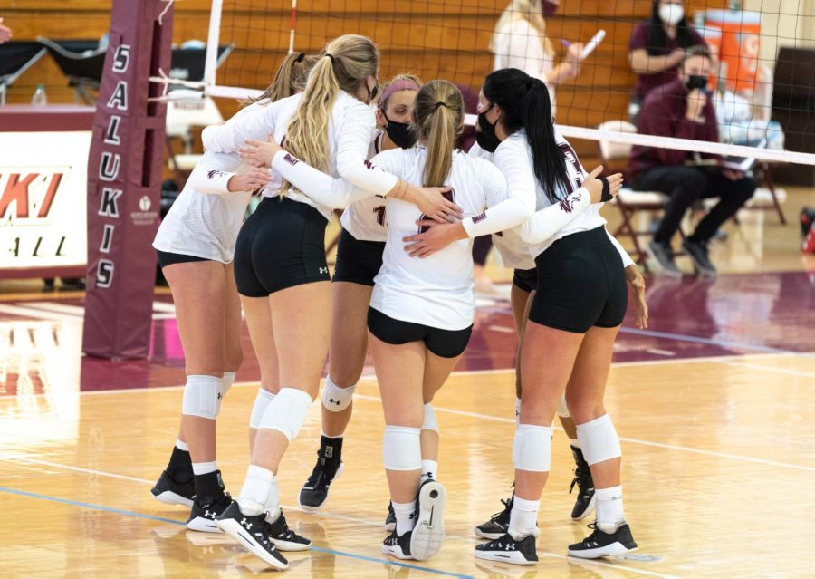 SIU Womens Volleyball players form a circle to cheer up and plan a tactical move to get level with the opponent team from Loyola University on Sunday, Feb. 7, 2021, in Davies Gym at SIU. The Salukis went on to lose in all three sets with score lines of 22-25, 13-25 and 17-25.