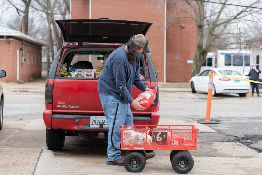 Donald Dunn loads food into his car on Sunday, Feb. 28, 2021, at Victory Dream Center in Carbondale, Ill.