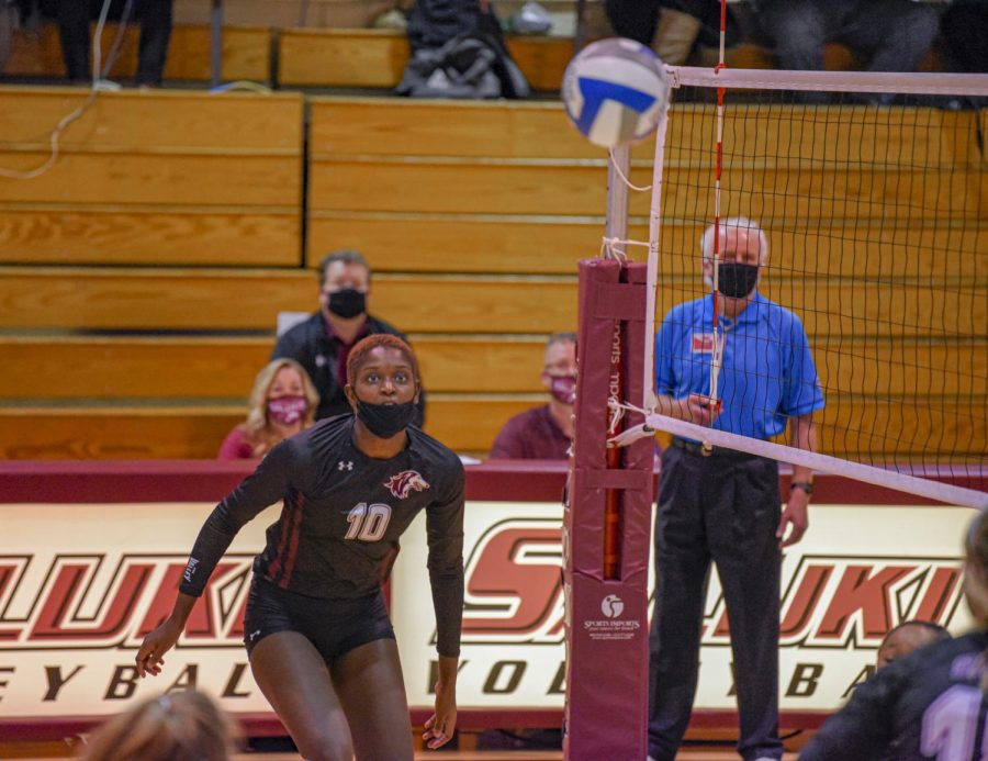 SIU outside hitter Savannah Sheridan watches as the ball returns over the net during a play against Loyola on Monday, Feb. 8, 2021 in Davies Gym in Carbondale, Ill. The Salukis' would go on to loss the match 0-3 to the Ramblers.