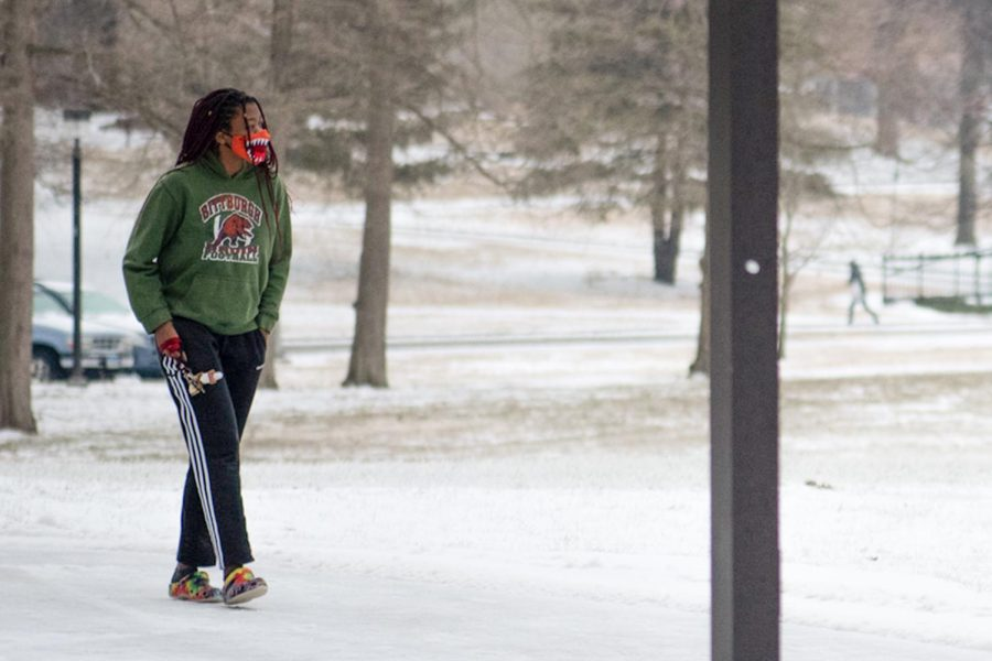 "Jordan Greer, a student at SIU, walks to Trueblood Dining Hall, despite the chilly winter weather in Carbondale, Ill. Wednesday, Feb.  10, 2021, She is currently a freshman with a major in Pre-Med and a minor in Art. ""I think that it's really cool that it's snowing,"" Greer says, ""But I'm ready for this weather to go away quickly."" According to an SIU Inclement Weather alert, classes beginning at or after 5 p.m. on Feb. 10 could be held virtually at the discretion of the professor. Notices of class format  changes for Feb. 10 will be sent out by faculty members. The release also said that in-person services provided by Morris Library, the Student Recreation Center and the Student Center will end at 5 p.m. and that the Saluki Express will stop running at 5:30 pm. More more information, please  visit siu.edu."