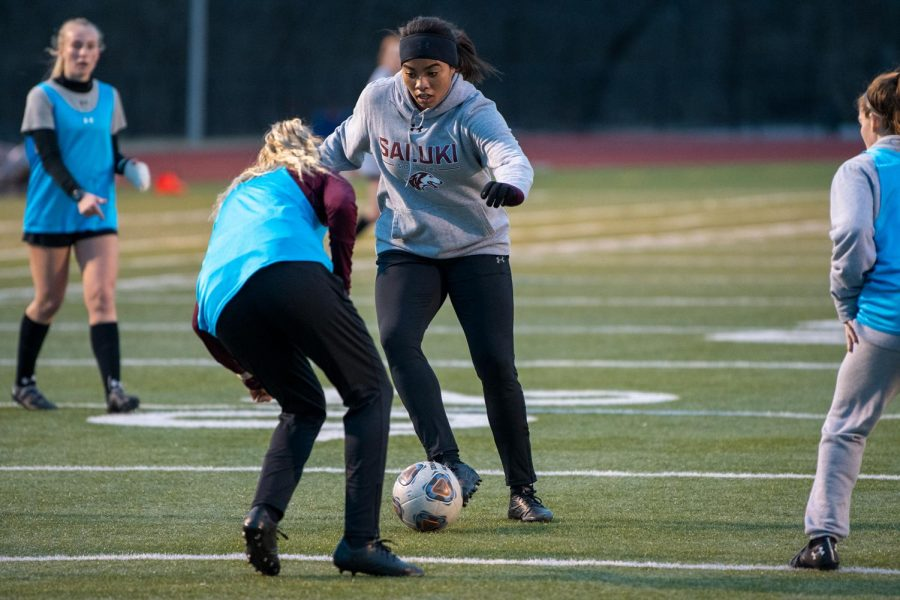 "Mia Edwards (freshman) kicks the ball during soccer practice on Friday, Feb. 5, 2021, at the soccer field at SIU. ""[Because] of COVID we don't have any games right now, but so far we are practicing on training and most prominently, we are having good practice time,"" Edwards said."
