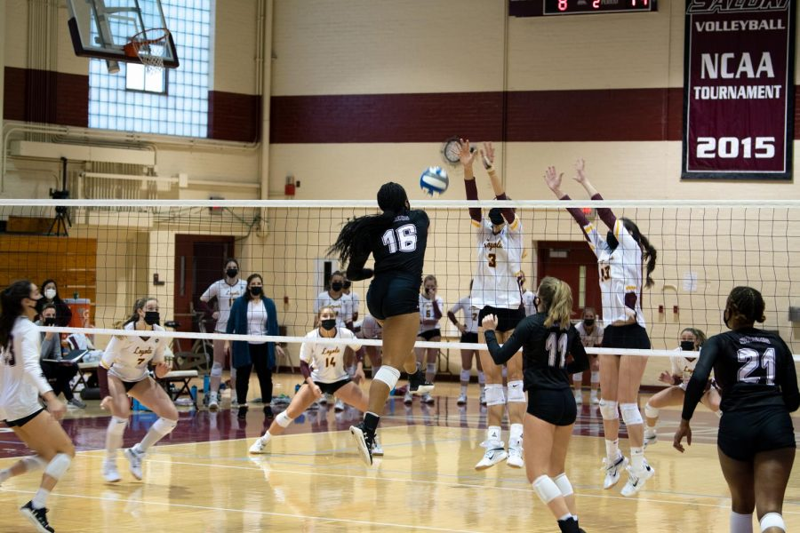 Imani Hartfield (14) spikes the ball towards the undefended area in the opponent's side of the court in the game against Loyola University on Monday, Feb. 8, 2021, in Davies Gym at SIU. SIU went on to lose all three sets.