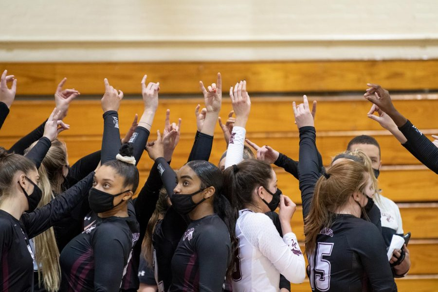 SIUC players cheer up in the break of the last set after getting feedback from the head coach in the game against Loyola University on Monday, Feb. 8, 2021, in Davies Gym at SIU.