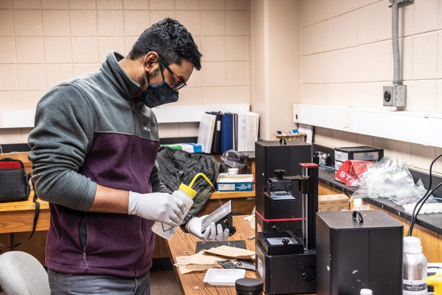 "Sukantu Dev Nath, a graduate student in Mechanical Engineering from Bangladesh, performs an experiment for his research on Wednesday, Feb. 10, 2021 in the Material Investigation Lab at Southern Illinois University Carbondale, Ill. ""COVID19 has directly affected my research since I have to wait longer to get the ordered research materials delivered. The practical classes are done online which is not effective. I wish to hold labs by having students physically there,"" Nath said."