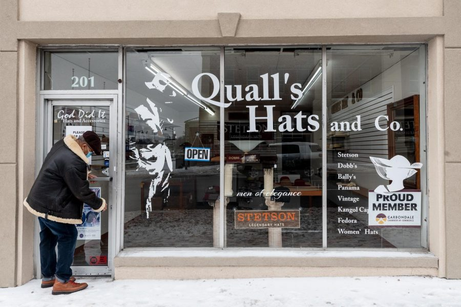 "Federick Martin Qualls, owner of Qualls Hat & Co., unlocks the door to his store Feb. 9, 2021. ""I started this store with my retirement fund in February 2020,"" Qualls said. He drives all the way from his house in Marion to his store in Carbondale four days a week. ""I usually come here around 9:00 a.m. and return back somewhere between 3-4:00 p.m,""  Qualls said."