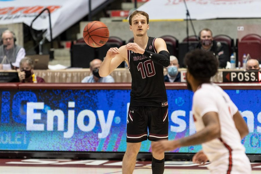 Ben Harvey (10) gives a no-look pass to his teammate staying at the edge of the opponents' court in a game against the Illinois State University Redbirds on Saturday, Feb. 13, 2021, at the SIU Banterra Center.
