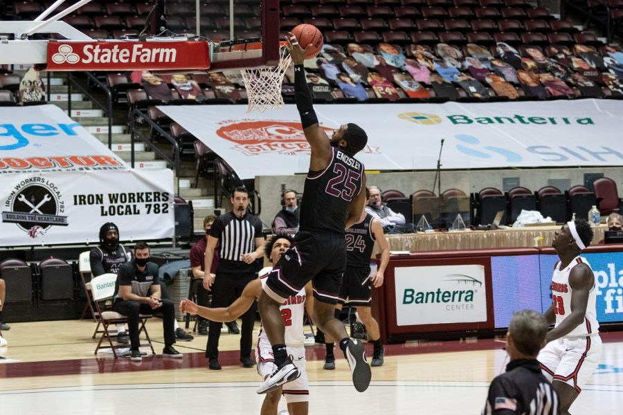 Jakolby Long (25) completes a layup in the game against Illinois State University on Saturday, Feb. 13, 2021 at the SIU Banterra Center.