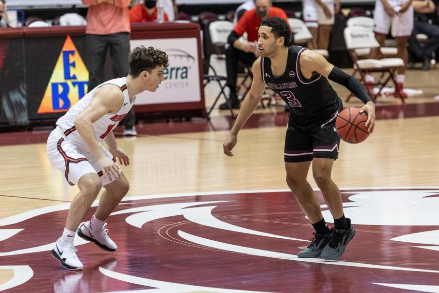 Dalton Banks (3) attempts to dribble to get past the opponent in the game against Illinois State University on Saturday, Feb. 13, 2021 at the SIU Banterra Center.