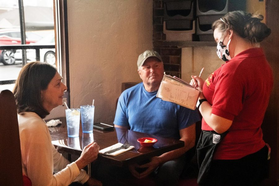 "Dwane Dryer and Brinda Dryer order their food at Quatro's Deep Pan Pizza on Friday, Feb. 25, 2021 in Carbondale, Ill. ""It's been 30 years we have been here every weekend,"