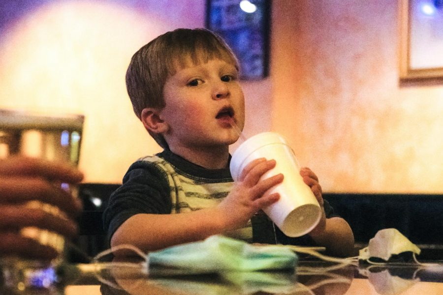 "Tripp Zollner enjoys his drink after school on Friday, Feb. 25, 2021 at Pagliai's Pizza in Carbondale, Ill. ""I love doing adventurous things. We went hiking last weekend and I love food,"" Zollner said."