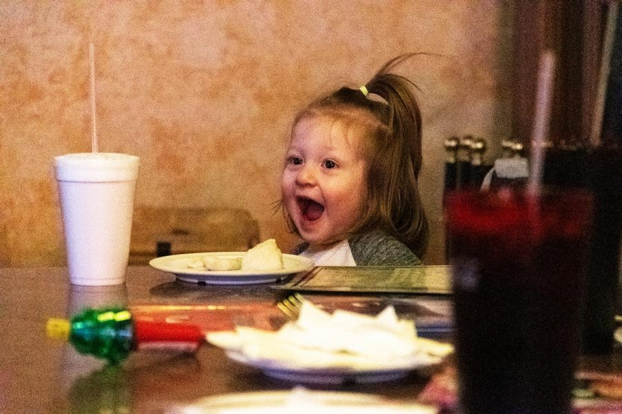 Rubby Zollner, 22 months, smiles after daycare on Friday, Feb. 25, 2021 at Pagliai's Pizza in Carbondale, Ill.