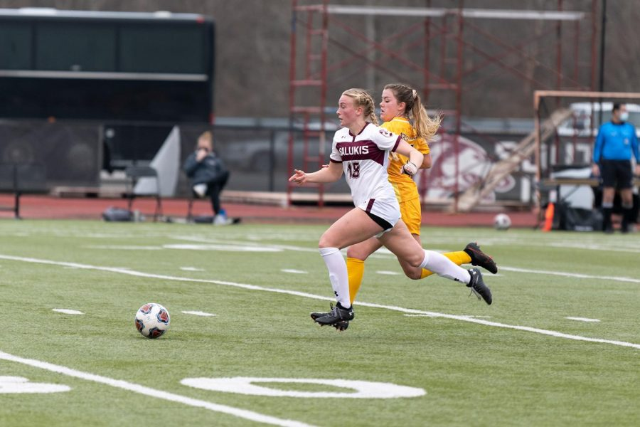 Ashlyn Henrie (18) chases the ball in the game against the Valparaiso Crusaders on Sunday, Feb. 28, 2021 at the Lew Hartzog Track & Field Complex in Carbondale, Ill.
