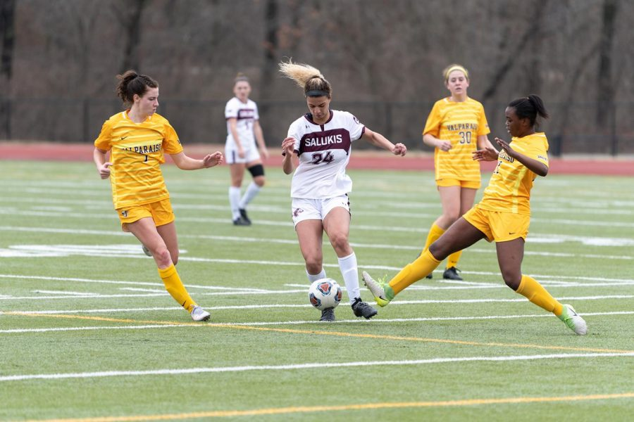 Maya Warrior (24) leads by dribbling down the field in the game against the Valparaiso Crusaders on Sunday, Feb. 28, 2021 at the Lew Hartzog Track & Field Complex in Carbondale, Ill.