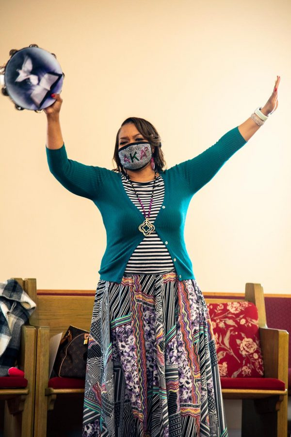 Neophansya Robinson, First Lady of Zion Temple COGIC, plays the tamborine during worship Sunday, Feb. 8, 2021, at Zion Temple COGIC church in Murphysboro, Ill.