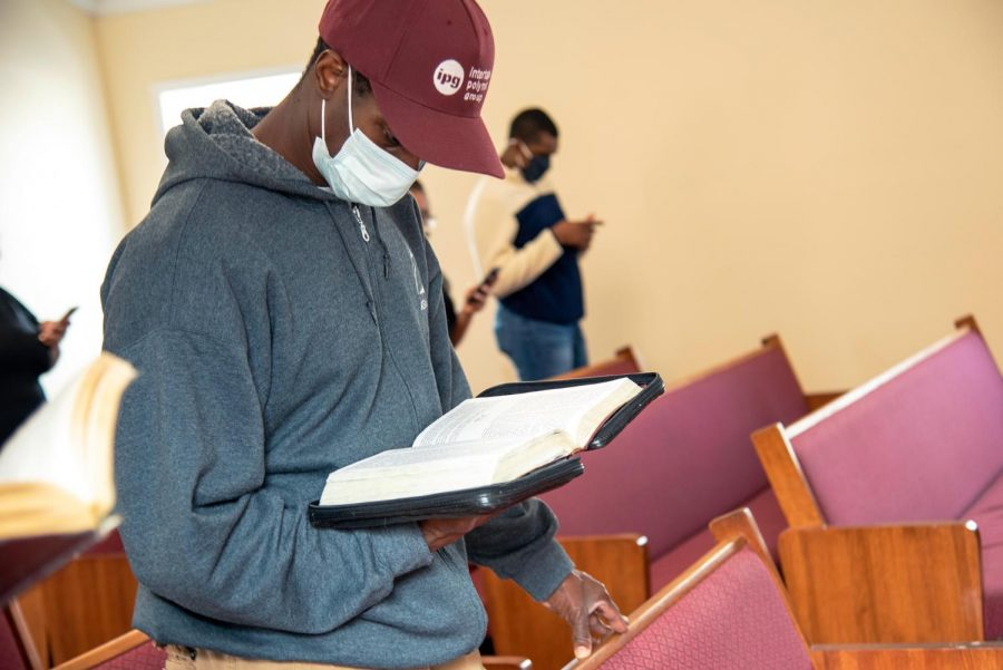 A member of Zion Temple COGIC church follows along with the sermon with his bible on Sunday, Feb. 8, 2021, in Murphysboro,