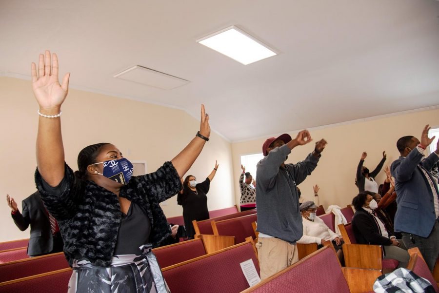 Members of Zion Temple COGIC sing and lift up their hands during worship on Sunday, Feb. 8, 2021, in Murphysboro, Ill.