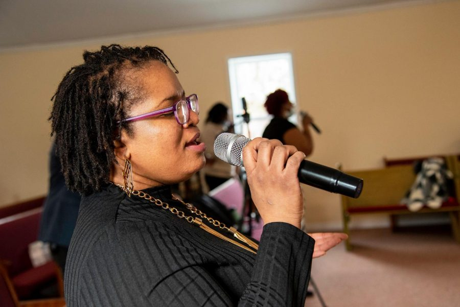 Edith Koine sings on the worship team on Sunday, Feb. 8, 2021, in Murphysboro, Ill. According to Neophansya Robinson, the women who sing on the praise team sing every Sunday and have not missed  one Sunday during the pandemic.