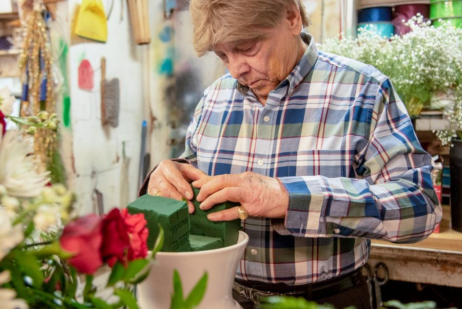 """Jerry Brooks, (77) owner of Jerry's Flower Shoppe, prepares a bouquet of flowers for a customer upcoming for Valentine's Day weekend on Thursday, Feb. 11, 2021, in Carbondale Ill. Brooks said the shop first opened in October of 1964. """"We're the only store front florist left in Carbondale. I never thought I would see the day we're the only florist shop in town,"""" Brooks said. He said that they are like one big happy family with their customers in Carbondale."""