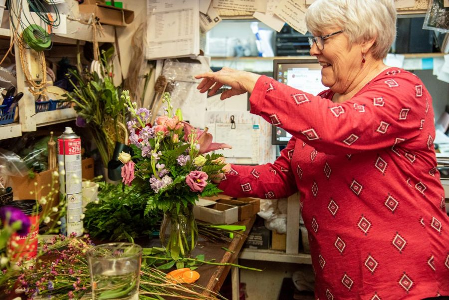 Dean McKinnies arranges a vase of flowers for a customer Thursday, Feb. 11, 2021, in Carbondale Ill.