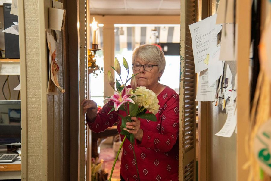 Dean McKinnies walks from the display room to get back to work for Valentine's Day Friday Feb. 12, 2021, in Carbondale Ill.