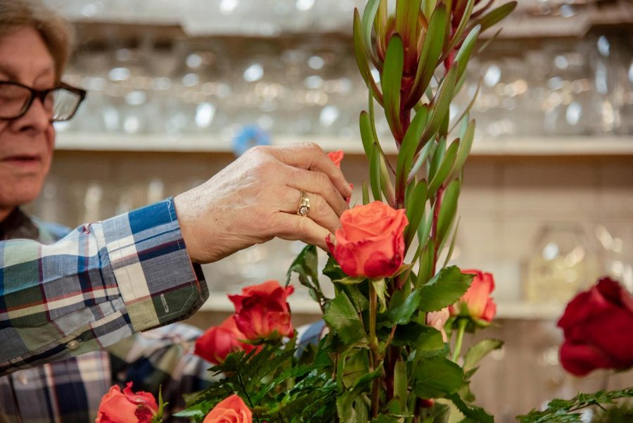 Jerry Brooks, 77, arranges a vase of flowers for a customer Thursday, Feb. 11, 2021, in Carbondale Ill.
