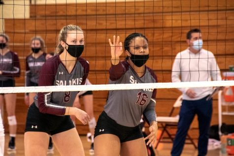 Hannah Becker (8) and Imani Hartfield (16) prepare to receive and block their opposing team, University of Iowa, on Feb. 22, 2021, Carbondale Ill.
