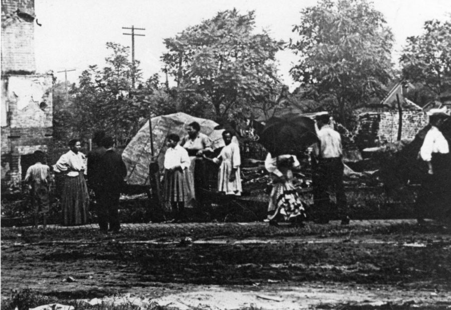 Group of African Americans inspecting damage. Photo courtesy of the Sangamon Valley Collection at Lincoln Library.