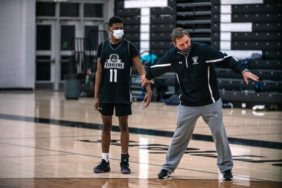 Coach Miller instructs DeMarcus Funchess during practice Monday, Feb. 8, 2021, at Carbondale Community High School. Miller has been the head coach of the Carbondale Terriers for 23 years.