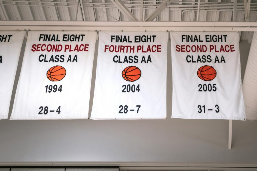 Banners hang in the gym Monday, Feb. 8, 2021 at Carbondale Community High School. The final two banners, marking fourth and second place rankings respectively, were led by Coach Miller during his career with the Carbondale Terriers.