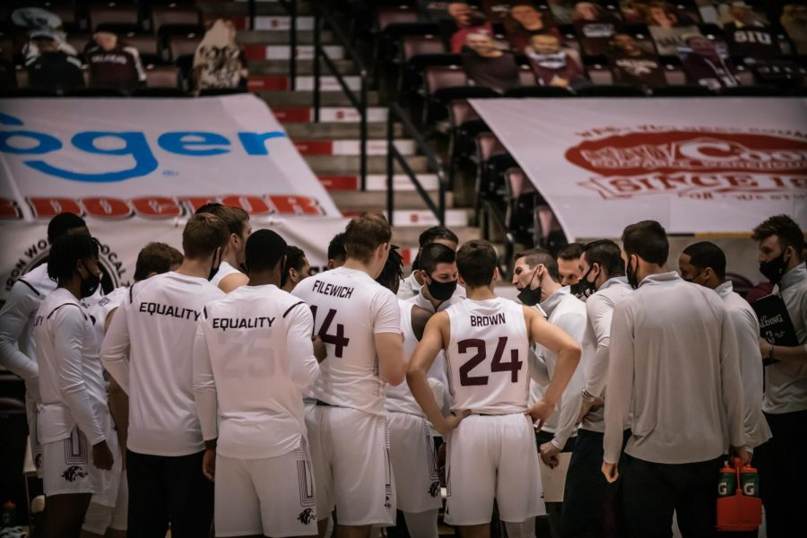 Head Coach, Bryan Mullins, instructs the team one last time before the end of the game against Illinois State University Sunday, Feb. 14, 2021, at the SIU Banterra Center.