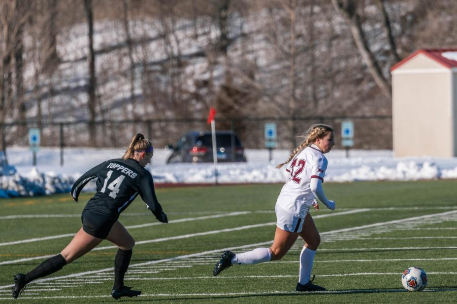 Madison Meiring (12) rushes in towards the goal in a game against Western Kentucky University Saturday, Feb. 20, 2021 at SIU.