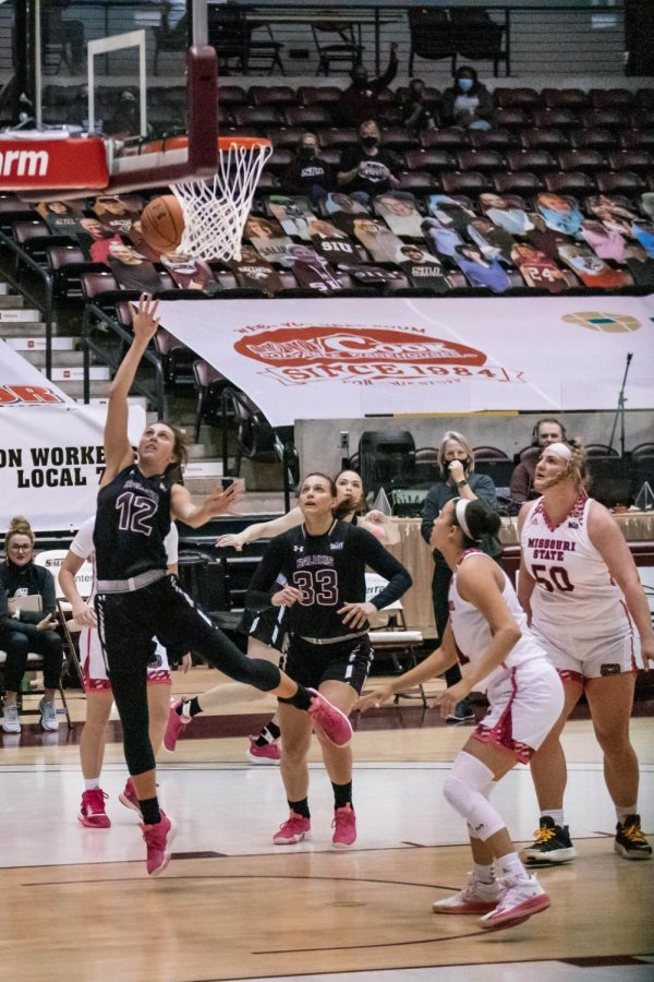 Mackenzie Silvey (12) rushes in for a layup in a game against Missouri State University Wednesday, Feb. 24, 2021, at the SIU Banterra Center.
