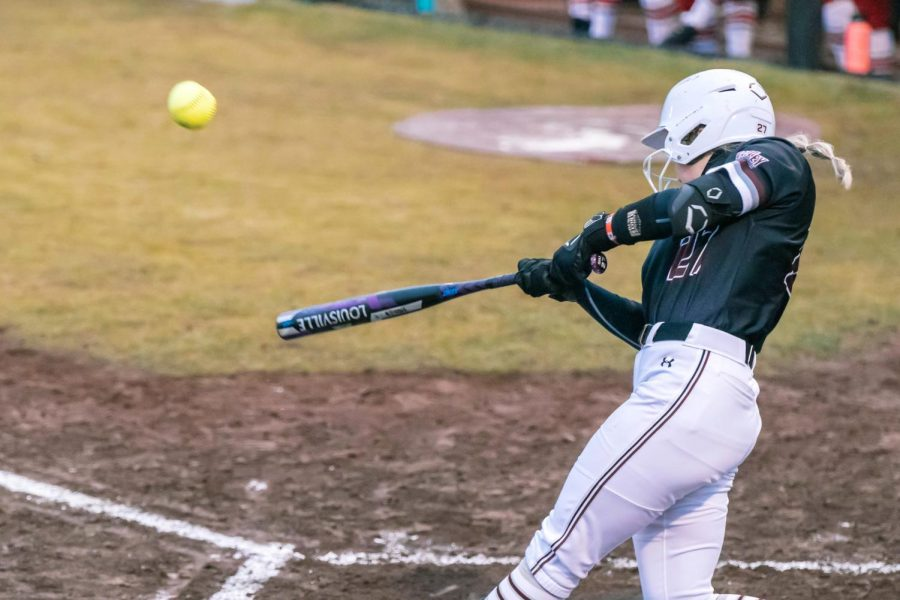 Maddy Vermejan (27) hits the ball in a game against Austin Peay State University Friday, Feb. 26, 2021 at SIU.