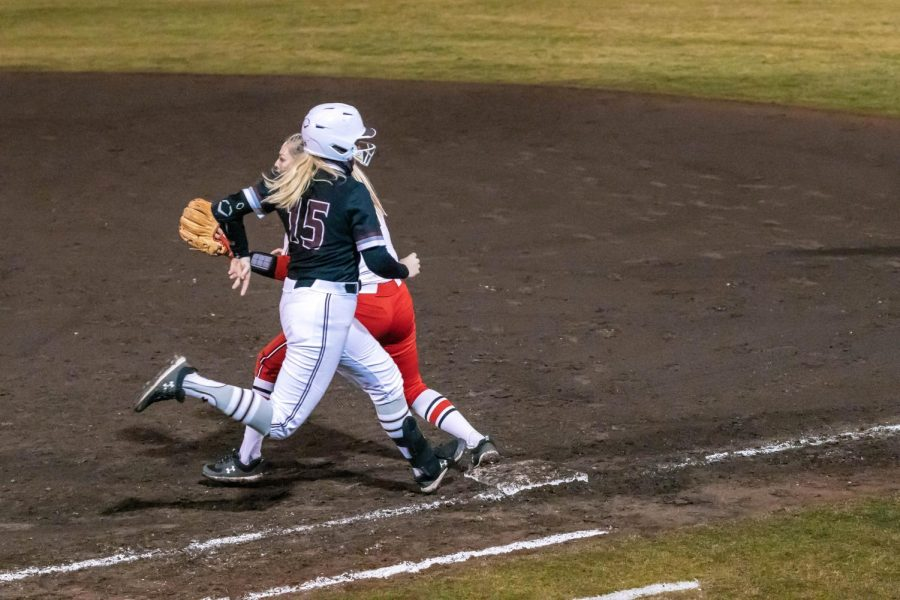 Ashley Wood (15) races to first base after hitting a single in a game against Austin Peay State University Friday, Feb. 26, 2021 at SIU.